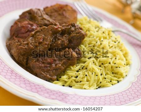 Meat Vindaloo with Pilau Rice - stock photo