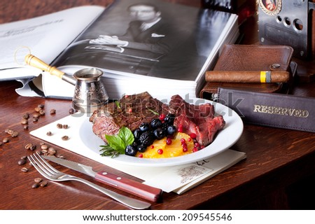 meat with berries still life business man - stock photo