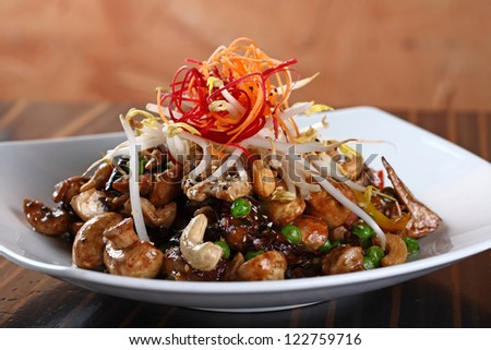 meat with cashew dish - stock photo