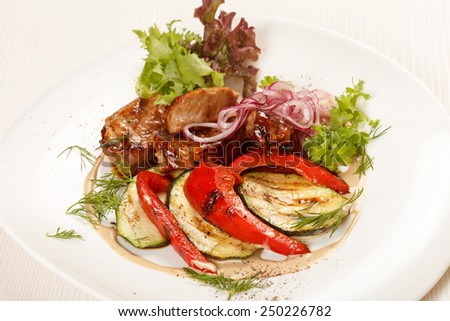 meat with grilled vegetables - stock photo