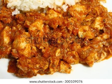 Meat with rice on wooden backdrop
