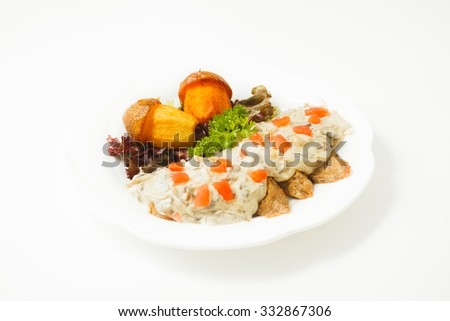 Meat with vegetables potatoes and gravy on a white background on a white plate - stock photo