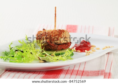 Meatball appetizer garnished with fresh endive and pine nuts  - stock photo