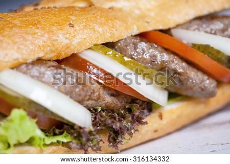 meatball sandwich with onion - stock photo