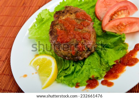 meatball with vegetables on plate - stock photo