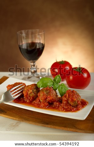 meatballs and tomato sauce on dish - stock photo