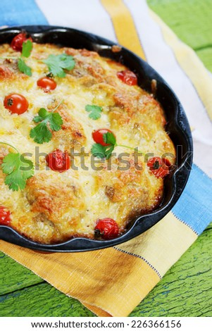 meatballs, baked with cheese and cherry tomatoes