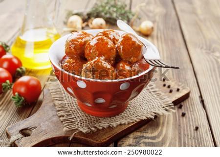 Meatballs in tomato sauce in the ceramic bowl - stock photo
