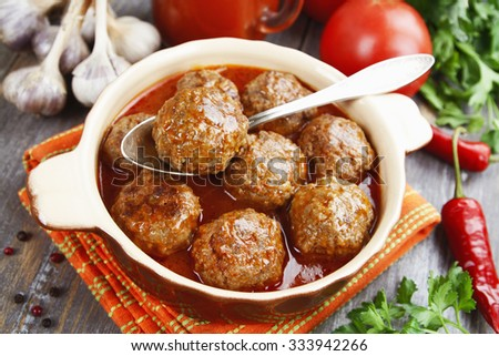 Meatballs in tomato sauce in the pan - stock photo
