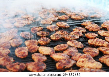 Meatballs on the barbecue. - stock photo
