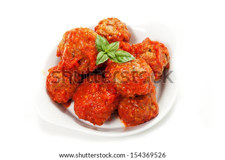 meatballs under meat sauce on white background - stock photo