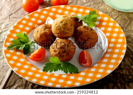 Meatballs with fresh fish on complex background - stock photo
