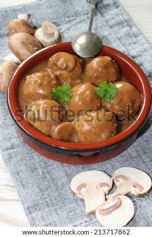 Meatballs with mushrooms - stock photo