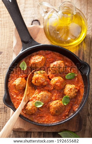meatballs with tomato sauce in black pan - stock photo
