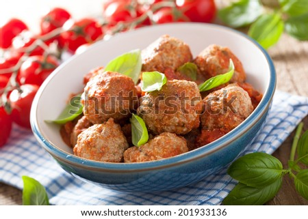 meatballs with tomato sauce in blue bowl - stock photo