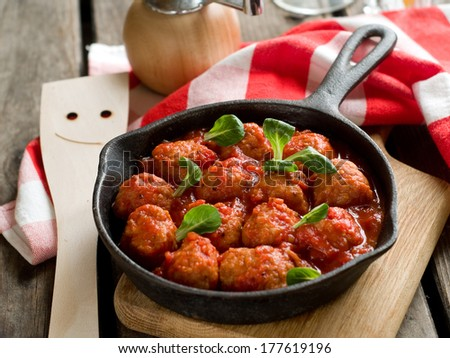 Meatballs with tomato sauce in pan, selective focus - stock photo