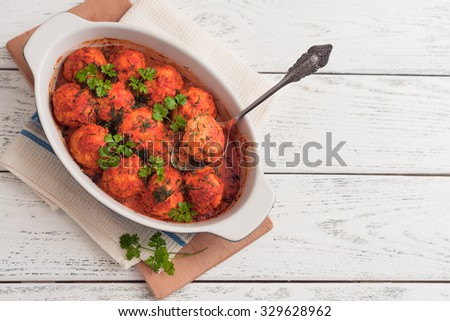 meatballs with tomato sauce on wooden background - stock photo