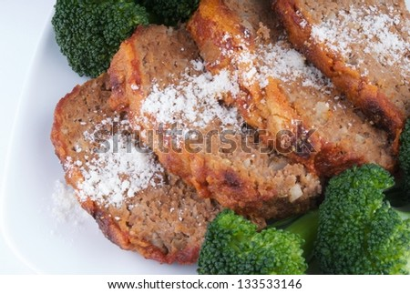 Meatloaf sprinkled with grated parmesan cheese - stock photo