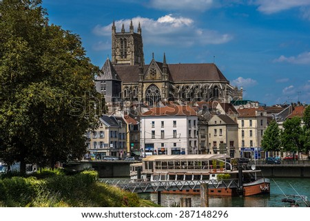 MEAUX, FRANCE - JUNE 13, 2015: View of picturesque Embankment of Marne River in Meaux - commune in Seine-et-Marne department in Ile-de-France region (metropolitan area of Paris, 41 km from Paris).