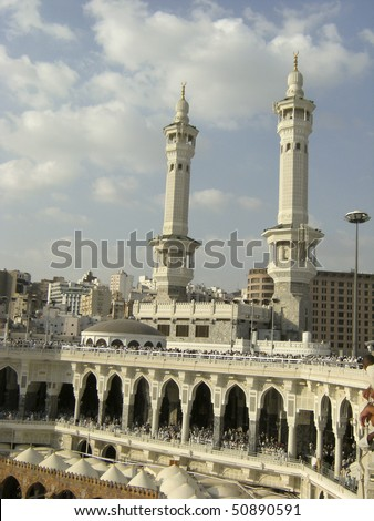 MECCA - DEC 8 : Close up view of two of the minarets at Haram Mosque Dec 8, 2007 in Mecca. The are nine minarets and four grand doors at Haram Mosque. - stock photo
