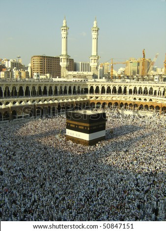 MECCA - DEC 9 : View from third floor of Haram Mosque where Muslim pilgrims circumambulate the kaaba Dec 9, 2007 in Mecca. Millions of muslims around the world come for hajj during this time. - stock photo
