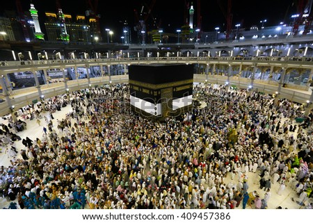 MECCA - JUNE 30 : Crowd of pilgrims circumambulate around Kaaba on June 30, 2015 in Mecca,Saudi Arabia. Pilgrims circumambulate seven times to show their submission to the religion. - stock photo