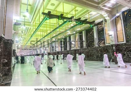 MECCA-MAR 13: Muslim pilgrims perform saei (brisk walking) from Safa mount from Marwah mount on March 13, 2015 in Mecca. Muslim pilgrims perform 7 rounds of saei from Safa mount to Marwah mount.  - stock photo