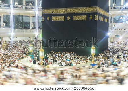 MECCA - MAR 11 : Muslims pray inside Hijr Ismail of Kaaba at Masjidil Haram Mosque on March 11, 2015 in Mecca. Muslims all around the world face the Kaaba during prayer time. - stock photo