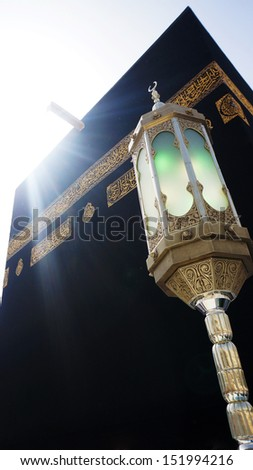 MECCA - MAY 26 : A close up view of  Kaaba at Masjidil Haram Mosque with the ray of light at the back May 26, 2013 in Mecca. Muslims all around the world face the Kaaba during prayer time. - stock photo