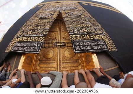 MECCA, SAUDI ARABIA-CIRCA MAY 2015: A close up view of Kaaba door at Masjidil Haram on MAY, 2015 in Makkah, Saudi Arabia. The door is made of pure gold.