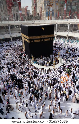 MECCA, SAUDI ARABIA-CIRCA MAY 2015: Muslims are doing tawaf around the Kaaba in Masjidil Haram in Makkah, Saudi Arabia. Muslims all around the world come here doing umrah and hajj - stock photo