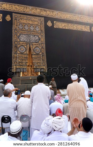 MECCA,SAUDI ARABIA-CIRCA MAY 2015: Muslims getting ready to pray in front of Kaaba door at Masjidil Haram on MAY,2015 in Makkah,Saudi Arabia.Muslims all around the world come here doing umrah and hajj - stock photo