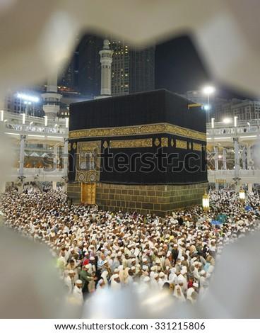 MECCA, SAUDI ARABIA-CIRCA OCT 14, 2014: A view of Kaaba Mataf at Masjidil Haram on OCT 14, 2014 in Makkah, Saudi Arabia. Muslim pilgrims from around the world performing their hajj. - stock photo
