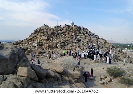 MECCA, SAUDI ARABIA - FEB 3: Muslims at Mount Arafat (or Jabal Rahmah) February 3, 2015 in Arafat, Saudi Arabia. This is the place where Adam and Eve met after being overthrown from heaven. - stock photo