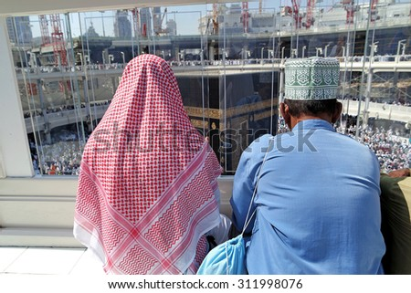 MECCA, SAUDI ARABIA - FEBRUARY 2: Muslims praying on the top floor of the Kaaba on February 2, 2015 in Mecca, Saudi Arabia. Muslim people praying together at holy place. - stock photo