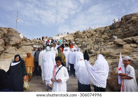 MECCA, SAUDI ARABIA - JUNE 2: Muslims at Mount Arafat (or Jabal Rahmah) June 2, 2015 in Arafat, Saudi Arabia. This is the place where Adam and Eve met after being overthrown from heaven.