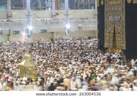 MECCA, SAUDI ARABIA-MAR 11, 2015: WIde angle view of Muslim pilgrims circumambulate the Kaaba counter-clockwise at Masjidil Haram in Makkah, Saudi Arabia. - stock photo