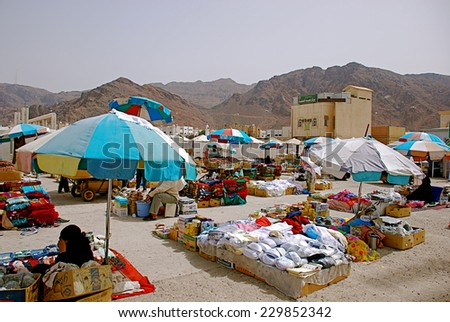 Mecca, Saudi Arabia - May 3 2007: Local market selling clothes and carpets - stock photo