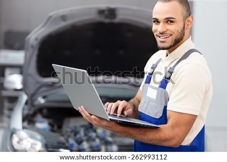 Mechanic, Auto Repair Shop, Computer. - stock photo