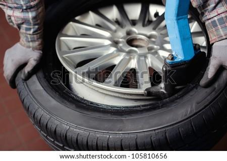 Mechanic changing  car tire closeup - stock photo