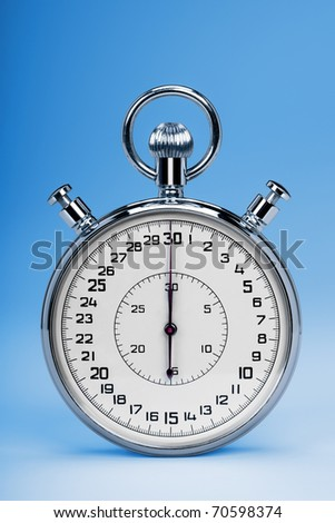 Mechanic chromed stopwatch on blue background. Front view. - stock photo