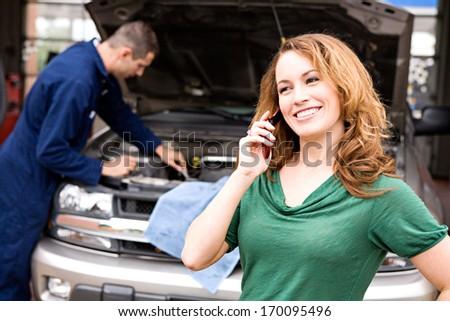 Mechanic: Customer on phone. - stock photo