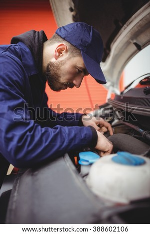 Mechanic fixing the engine of a van