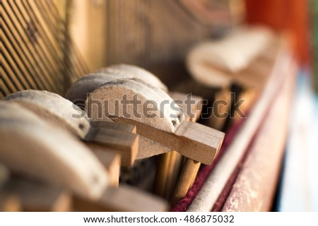 Mechanic hammers and strings inside old piano