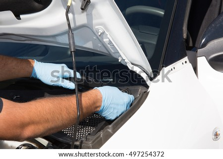 Mechanic man at work on a car repairing