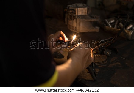 Mechanic or Electrician testing the light with multimeter meter - stock photo