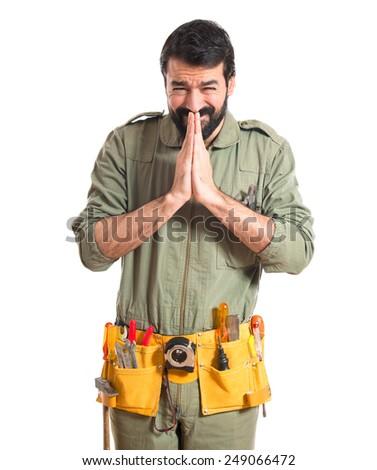 Mechanic pleading over white background  - stock photo