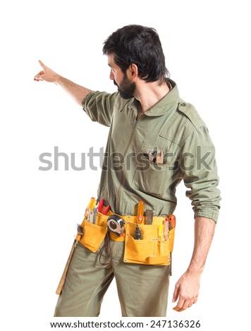 Mechanic pointing back  - stock photo