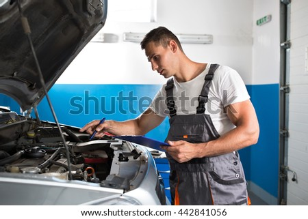 Mechanic showing and checking a damage