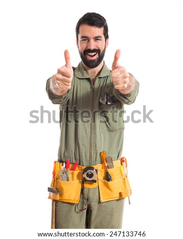 Mechanic with thumb up  - stock photo